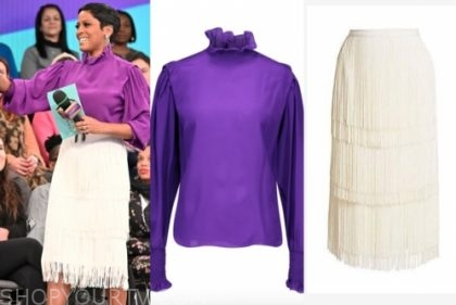 tamron hall's purple ruffle blouse and white fringe tiered skirt