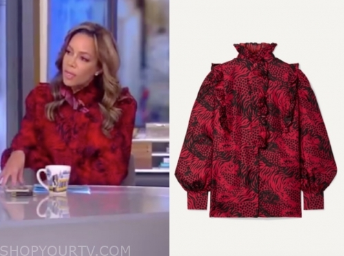 sunny hostin's red and black printed blouse