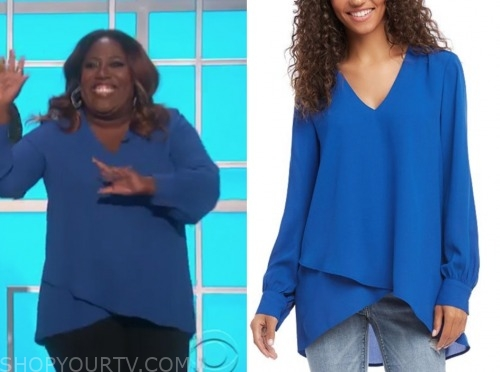 the talk, sheryl underwood, blue v-neck top