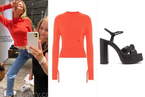 nicola peltz, orange sweater, black sandals