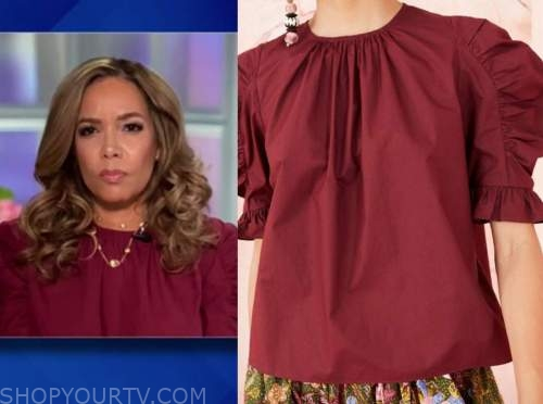 sunny hostin, burgundy red puff sleeve top, the view