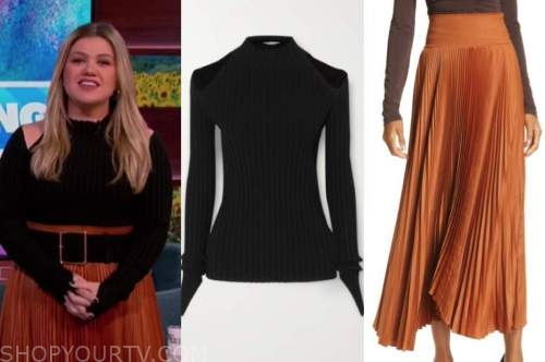 kelly clarkson, the kelly clarkson show, black cold-shoulder sweater, orange pleated skirt