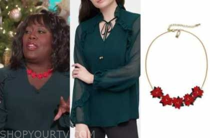 sheryl underwood, green ruffle blouse, red Poinsettia flower necklace, the talk