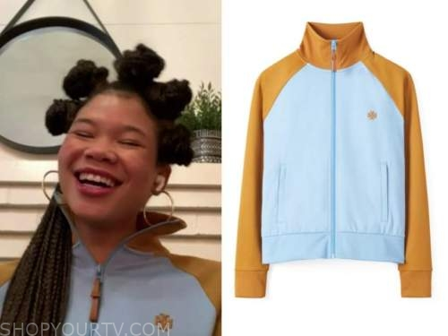 storm reid, the talk, orange and black track jacket