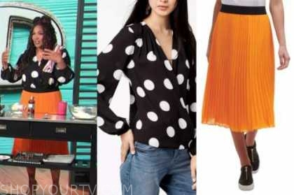 kym whitley, E! news, daily pop, orange pleated skirt, black polka dot top