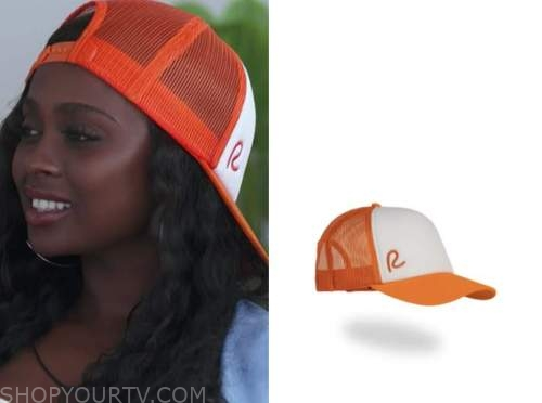 trina, love island usa, orange and white trucker hat